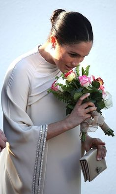 The Duchess of Sussex dazzled in a sweeping kaftan-inspired Dior gown as she joined husband Prince Harry for a reception at the British ambassador's residence in Morocco on Sunday night. Prince Harry And Megan, Prince Henry, Harry And Meghan, Royal Prince, Traditional Henna, Dior Gown, Prinz Charles, Sussex, Prinz Harry
