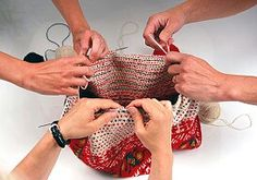 The traditional way of making the Korsnäs sweater: three ladies knitting the middle part at the same time. Generally the tapestry crocheted parts were made by the male master | Tillverkning av Korsnäs-tröja, Finland