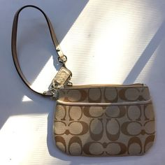 Coach Wristlet Gently used Coach wristlet, a little worn but still in wonderful condition! Coach Bags Clutches & Wristlets