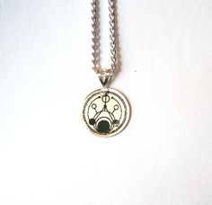 Doctor Who Gallifreyan Symbol Necklace by TimeMachineJewelry