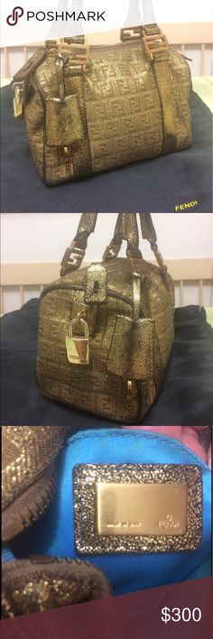 Authentic Fendi Gold Glitter Bauletto Purse Authentic Fendi Gold Glitter Bauletto Purse in great condition. Dust bag, lock, & keys included. The handles have wear, please see photos. It is a stunning bag that shines gorgeously in the light. Interior lining underneath near zipper has wear please see photos. Fendi Bags Mini Bags
