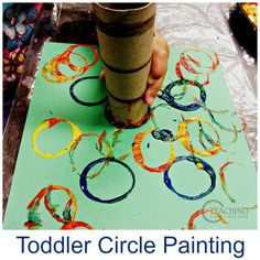 Toddler circle painting is a perfect first art activity. All you need are paper tubes and paint. Easy for toddlers to handle!
