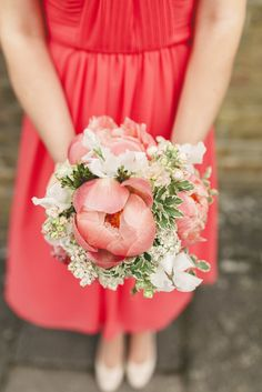 These lush flowers compliment the coral dress beautifully. Photo by Benjamin Stuart Photography #weddingphotography #bridesmaid #weddingflowers #coralwedding