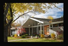LOVE mid-century modern front windows and roof line. Gray color too.