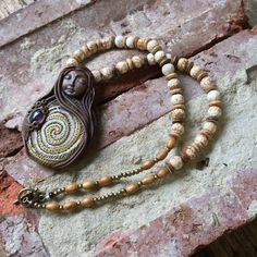 Spiral Goddess Necklace with Amethyst and Ice flower by TRaewyn