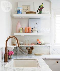 Love Te marble backsplash shelving in kitchen. Bronze faucet. http://www.styleathome.com/homes/interiors/interior-feminine-glam-home/a/46094/14