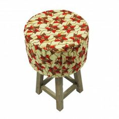 The Triangle Sugar Footstool is a hardwood footstool with a removable ethnic design, java print 100% cotton cover.