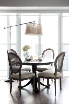 "RoomReveal - Dining room, Absolute condo by Anna Melnikova  I love this in a small space.  If you have to create a dining space, you can create a ""chandelier"" by using a floor lamp with an arc over the table.  ...And I love a round table."