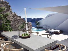 Cave-Like Villa in Greece Hides Sculptured Living Spaces - https://freshome.com/cave-like-villa/