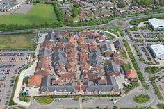 An aerial photograph of Freeport Outlet Village in Braintree, Essex Braintree Essex, Outlet Village, Essex England, Aerial Photography, Aerial View, Medieval, Dolores Park, Commercial, Places