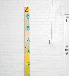 Measure Me Stick By Jody Work & Donna Piacenza. I have this and really like it, but the hardware to attach it is not very useful. Wooden Height Chart, Measuring Stick, Art Wall Kids, Wall Art, Decoration, Playroom, Crafty, Cool Stuff, Kid Stuff