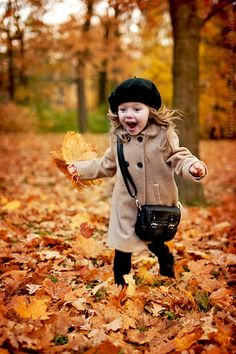 Cute Child ~ jumping in the leaves