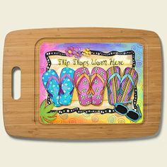 """Paradise Found Summer Flip Flops Bamboo Cutting Board by Highland Graphics. $25.88. Measures approx 15.25"""" x 11"""" x .5"""". Durable Tempered Glass and Eco-Friendly Bamboo. Hand Wash with Warm Soapy Water. Harvested from Renewable Resources. Beautiful Color and Grain, Harder than Maple. Paradise Found Summer Flip Flops Bamboo Cutting Board"""