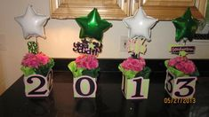 Got the boxes, tissue paper, and balloons from dollar tree and covered them with scrapbook paper. Boxes with class year numbers-centerpiece Graduation Decor