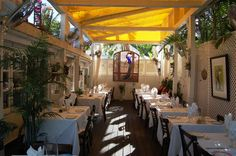 Cafe Sole- 1029 Southard St. Key West, FL Free Bottle of select WIne with the purchase of 2 entrees when you use your Gold Card Key West.