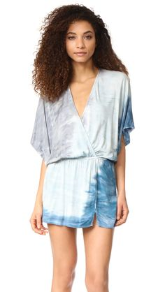 A tie-dye Young Fabulous & Broke dress styled with a surplice neckline and a faux-wrap skirt. Smocked elastic cinches the waist. Short dolman sleeves