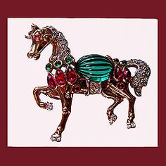 Highly collectible signed TRIFARI Moghul horse brooch.    http://www.letsgetvintage.com/moreinfo.php?id=1353