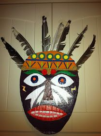 Recycled cardboard African mask for a topic on World Art. Coloured with poster paints and embelished with gold braid and cardboard mouth ...