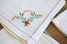 4 vintage linen hand embroidered set cloth luncheon cocktail napkins. $5.00, via Etsy.