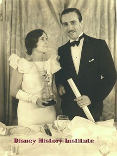"""Walt & Lillian Disney at the 5th Annual Academy Awards where he was picking up the Honorary Special Award for the creation of Mickey Mouse as well as an Oscar for Short Subject (Cartoon) for the Silly Symphony """"Flowers and Trees."""" The event was held on November 18, 1932 at the Fiesta Room of the Ambassador Hotel."""