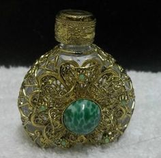 Perfume Bottle Glass Enclosed With Filigree Goldtone Metal Green Stone On Front photo