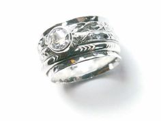Hey, I found this really awesome Etsy listing at https://www.etsy.com/listing/254863945/silver-spinner-rings-cubic-zirconia-ring