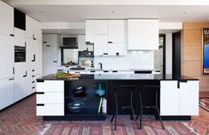 Marimekko House kitchen by Ariane Prevost - Google Search mondrian style kitchen with black handles