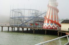 Clacton Pier through the Sea mist one of the UK's few surviving piers at over a hundred years old.........
