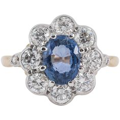 Pale Ceylon Sapphire 8 Stone Diamond Gold Cluster Ring | From a unique collection of vintage cluster rings at https://www.1stdibs.com/jewelry/rings/cluster-rings/