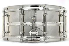 """Joyful Noise 14 x 6.5"""" Modern Classic Standard Snare Drum with seamless brass shell polished to a brilliant luster and bright nickel-plated. 2.5mm solid brass bright nickel-plated triple flanged hoops, ten solid brass bright nickel-plated Corder tube lugs, bell-flanged bearing edges, vintage-inspired crimped snare beds, 24k gold-plated brass JNDC feather motif drum badge and the bright nickel-plated proprietary cast bronze """"One Touch Classic"""" snare drum strainer system."""