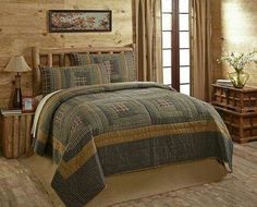 Merrick Cabin's patchwork log cabin blocks of plaid fabrics include cream, gree, navy blue, brown, black and tan with a sashing of solid deep khaki tanBacking is solid deep khaki cotton and machine washableQuilt measures and co. Quilt Sets Queen, Valentines Sale, Primitive Homes, Custom Quilts, Plaid Fabric, King Size, Home Kitchens, Bedding Sets, Decorative Pillows