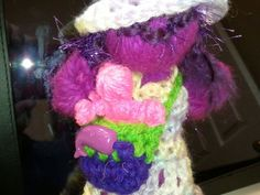 Working on a series of yarn dolls with carrying box.