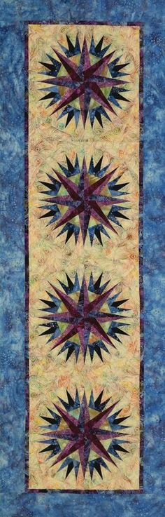 Upcoming Publication! The Compass Rose Table Runner is the PERFECT compliment to your Mariner's Compass pattern, or a stand alone striking piece to make every Table a show piece! Using the Center Compass Rose block in the Mariner's Compass, this pattern is quick and straight forward...with NO curved piecing and floating points! To be shown at Spring Quilt Market 2013 and published early summer 2013!