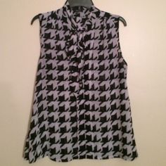 XOXO Houndstooth Dress Tank Black and gray houndstooth print. A dressy tank for work with a long bow tie. Very fun and feminine! Great condition. XOXO Tops Tank Tops