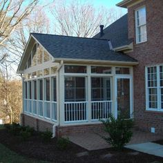A gable roof was the right choice for this home's eze breeze window room addition. Building the room on a brick foundation makes the room seem like part of the original home.