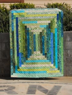 Jelly Roll Quilt - a stretched variation of Courthouse Steps