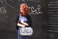 leather dress and snakeskin purse