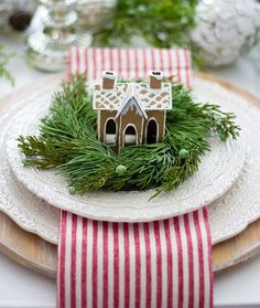 how cute is this idea for a Christmas table? love the wreath, gingerbread house on the striped napkin and white plats Christmas . Christmas Gingerbread, Noel Christmas, Merry Little Christmas, Winter Christmas, Woodland Christmas, Gingerbread Houses, Christmas Vacation, Xmas, Outdoor Christmas