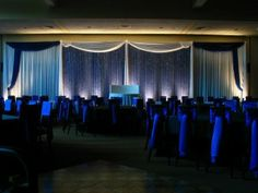 Monochromatic Blue Color Palette with Blue Uplighting and Crystal Blue Backdrop from @Elegant Event Lighting!