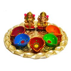 Traditional Thaali Hamper includes: Beautifully decorated thaali. Diameter: 9.5 inches. 5 colorful diyas. Ganesha & Laxmi idols. Height: 3 inches each. Rs. 699 ($11.46) http://www.tajonline.com/diwali-gifts/product/d3888/traditional-thaali/?aff=pint2013/