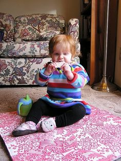 Oilcloth mat works great for wee ones who might spill or drop crumbs.  Also works well as a picnic blanket.