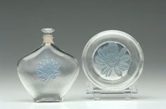 """R. LALIQUE Perfume bottle and box, """"Aster,"""" clear with blue patina, c. 1913."""