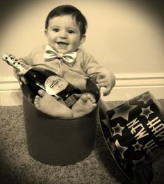 Happy New Year baby photo idea! All you need is a bucket, champagne, infant bow tie (purchased at H&M) and a New years hat. Tada! Cutest baby boy of the year!