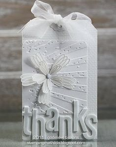great textures for the white-on-white. uses Tim Holtz embossing folder.