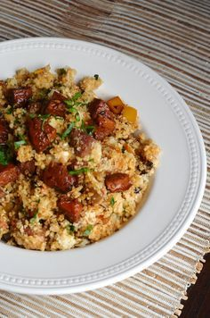 A paleo recipe for cauliflower dirty rice with andouille sausage.