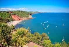 Complete with palm trees on the cliffs above, Babbacombe Beach is an intriguing cove where tales of smuggling and murder echo from the past. The historical Babbacombe Cliff Railway is a novel way to reach the beach.