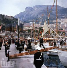 Prince Rainier and Grace Kelly before wedding.The Princess to be arrived in Monaco by the USS Constitution. Prince Rainier's yacht met the larger ship outside the harbour of Monaco.