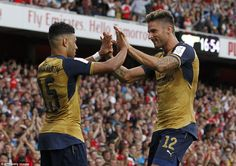 Former Southampton youngster Oxlade-Chamberlain celebrates his strike with French striker ...