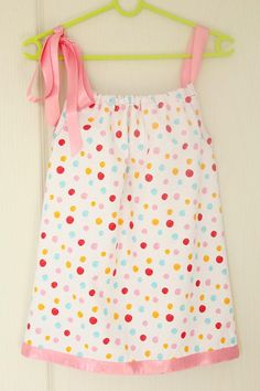 Transform an old pillowcase into a DIY pillowcase dress for your girl with this easy-to-follow tutorial.