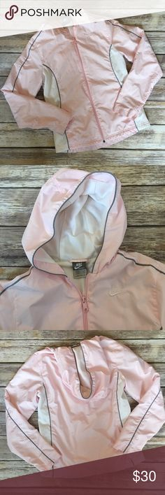 """Nike Rain/Windbreaker Jacket Light pink and white Nike windbreaker/ rain jacket. Fully zips up with a hoodie. Has a breathable lining ideal for outdoor workouts. Measures pit to pit 18""""/ front length 23.5""""/ back 24.5"""" Nike Jackets & Coats"""